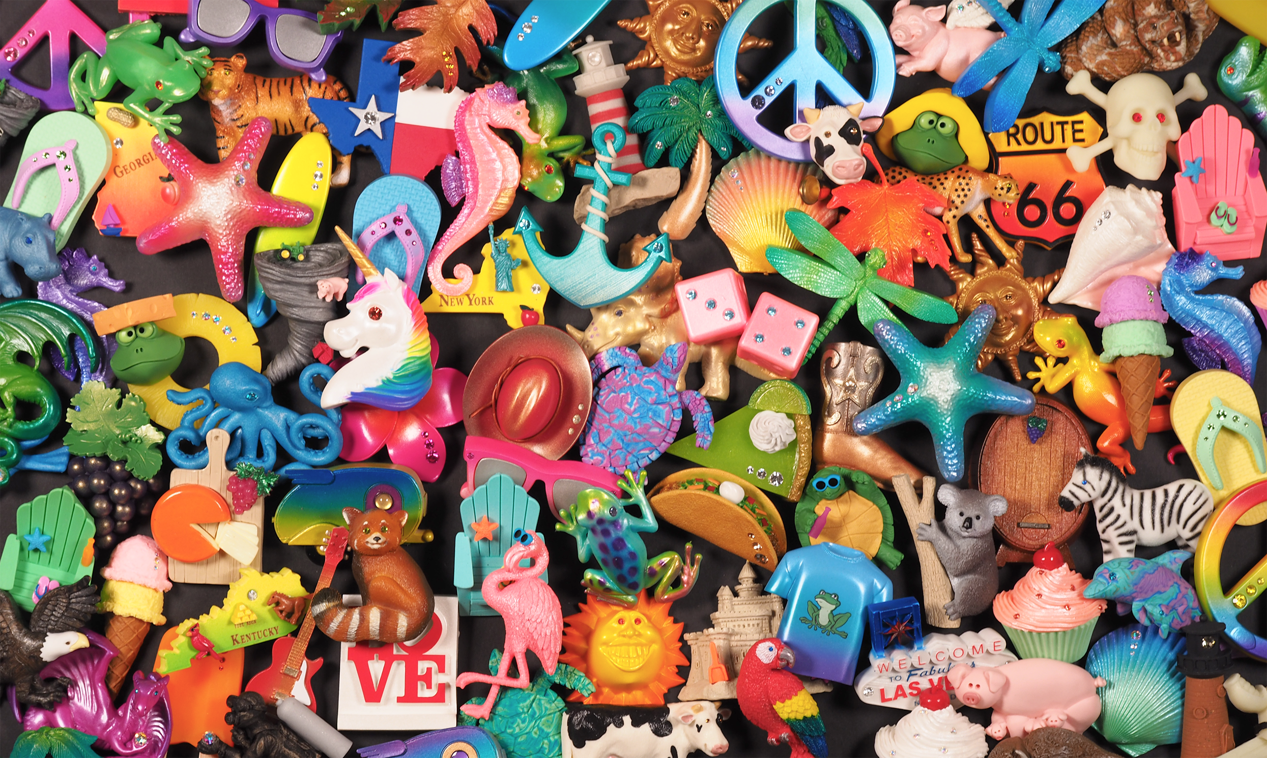 Hundreds of whimsical souvenir frig magnets available with your name-drop.